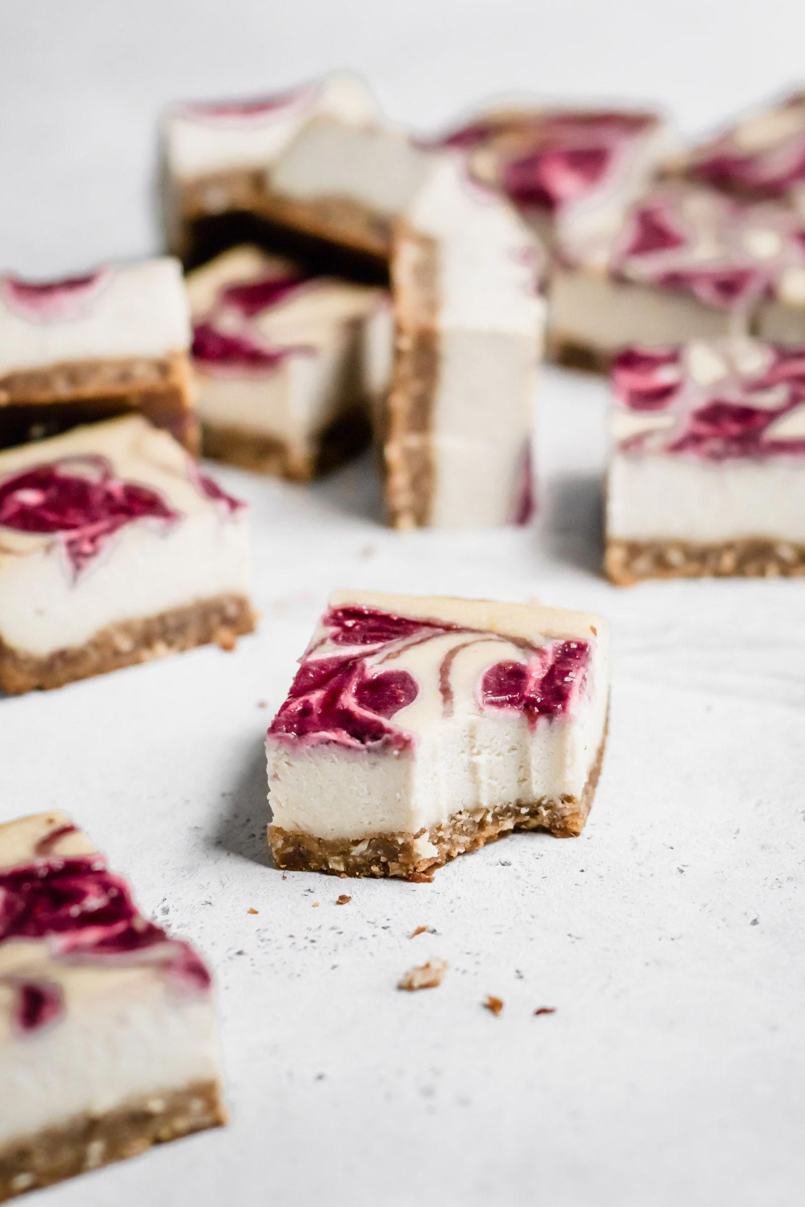 Paleo Lemon Raspberry Cheesecake Bars are the dessert of summer! These cheesecake bars are naturally vegan, made with cashews and coconut milk. They're incredibly creamy and decadent! #vegan #cheesecake #paleo #raspberry #lemon #glutenfree #vegandessert #paleodessert #cheesecakebars #grainfree