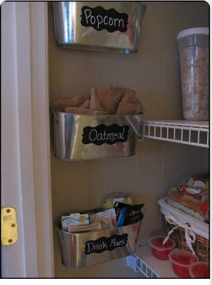 Use up that extra space in the pantry with hanging containers for oatmeal, popcorn, drink mixes, and seasoning packets. Gets rid of the boxes and saves additional room that way as well!