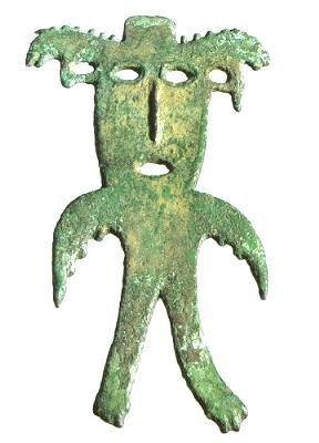 A bird-man with theriomorphic headdress and wings. A bronze stud from the Perm province. 1st-3rd centuries.