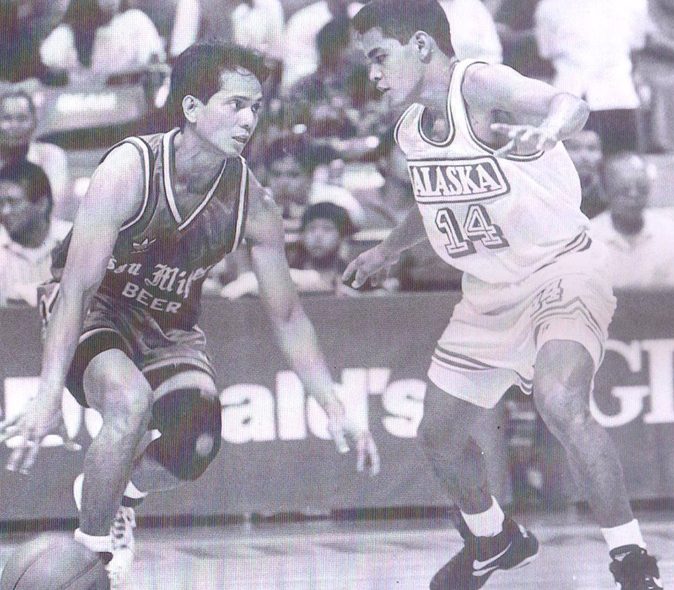 Hector Calma Of The San Miguel Beermen Dribbling The Ball Against Johnny Abarrientos Of The Alaska Milkmen During The Action O Baseball Cards Hector San Miguel