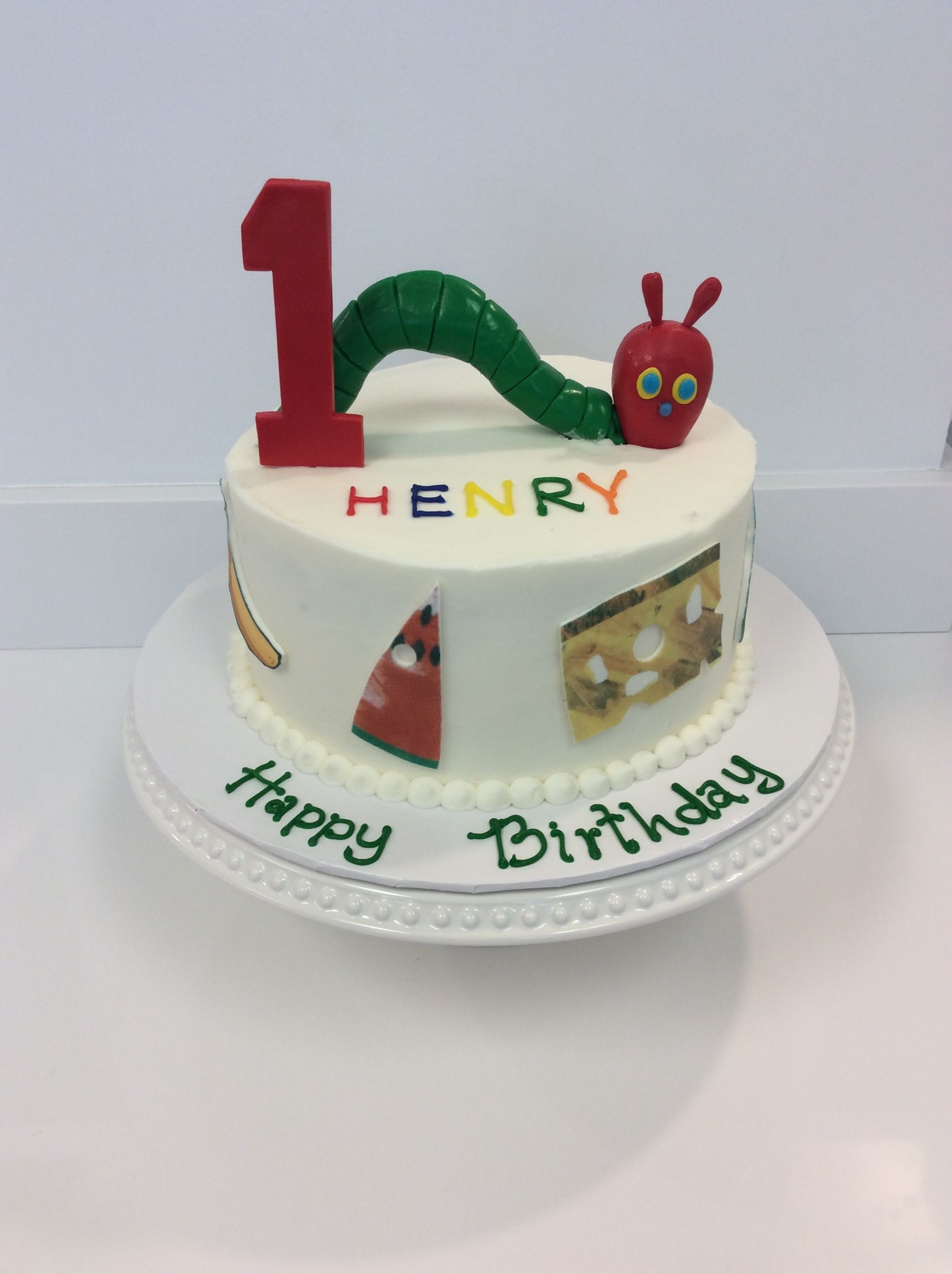A fun cake themed around the hungry hungry caterpillar