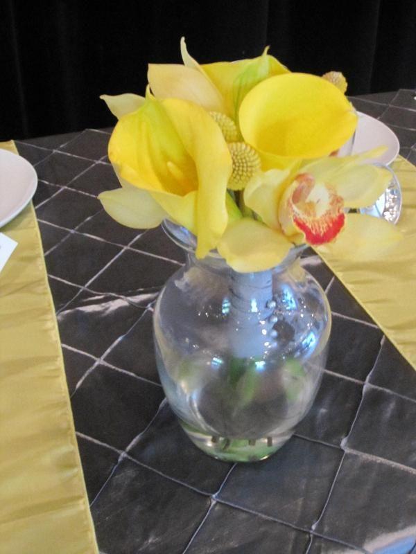 Callas, cymbidiums, & Craspedia bouquet