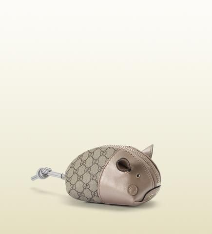 e433131dd47 pig purse   gucci. oh my...cuteness! (too bad it s gucci...makes it  unaffordable   impractical for me to own  ( )