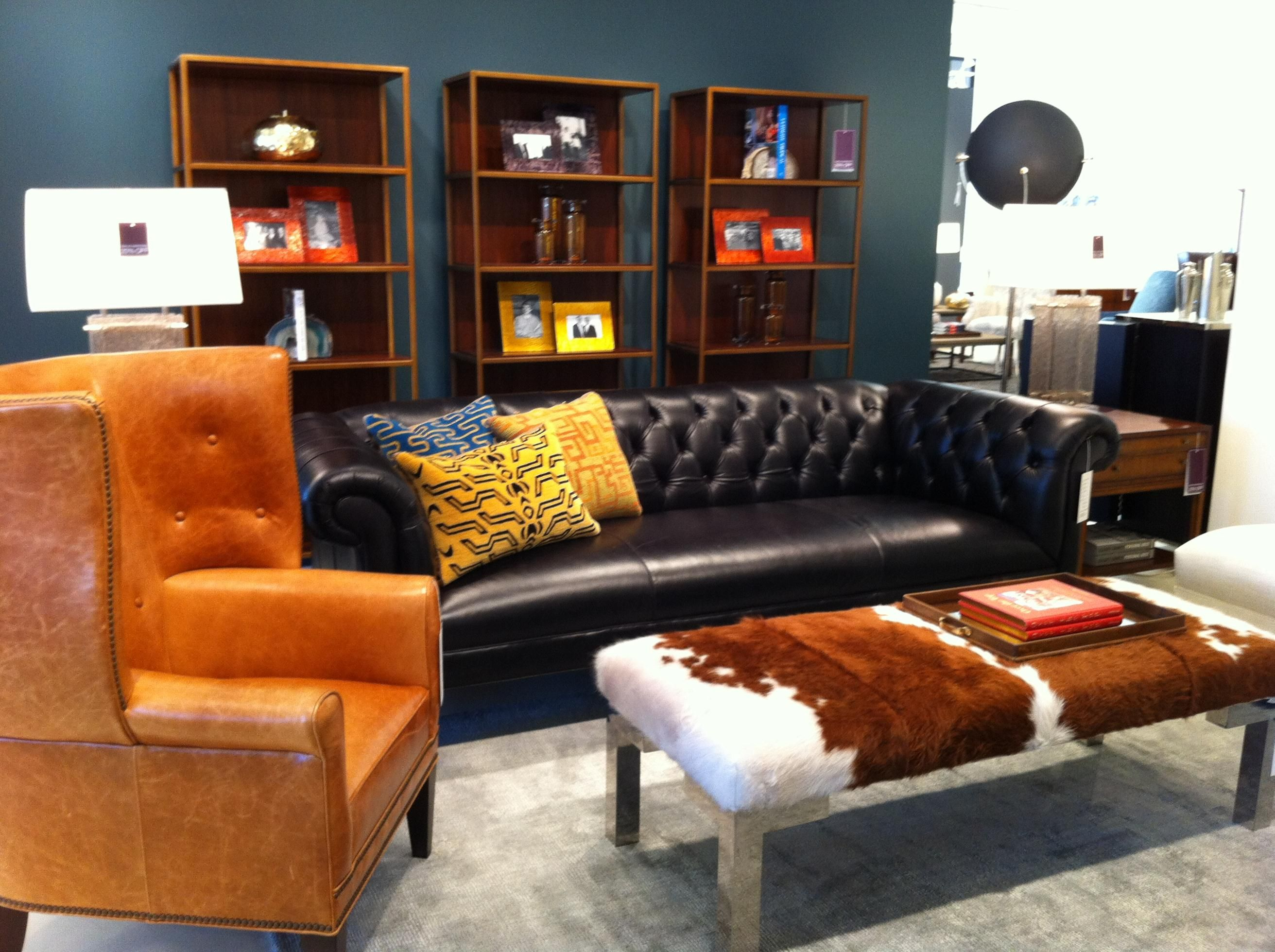 Love the color combo hide coffee table is a nice touch living