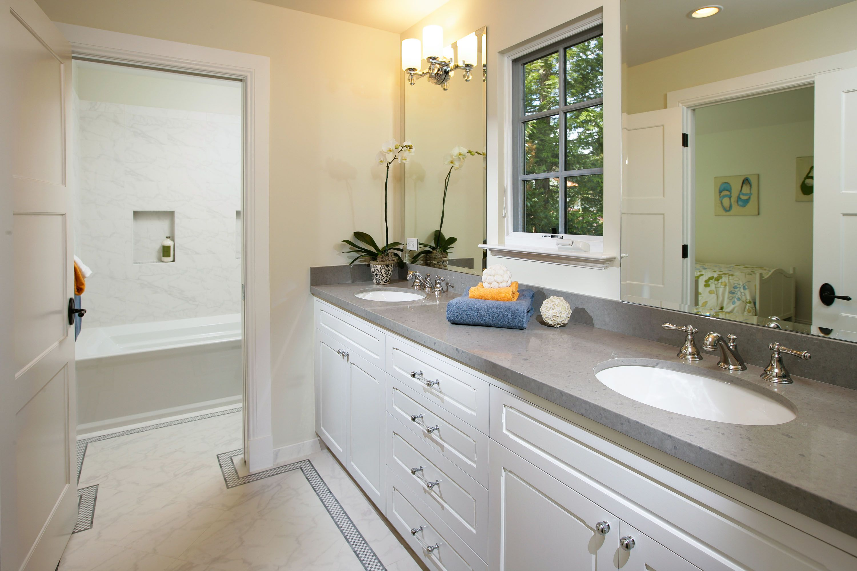 Bathroom with dual vanities the floor and shower wall tile is dal
