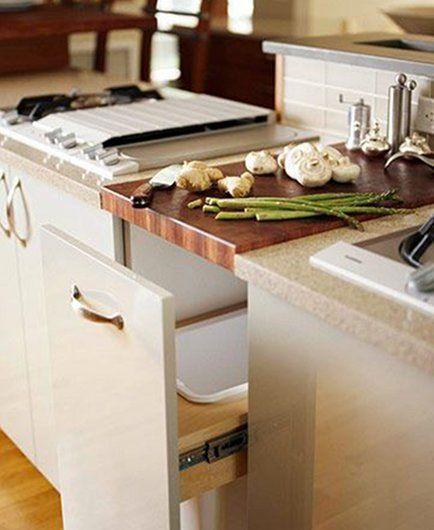 integrated butcher block cutting board above pull out trash bin ...