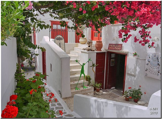 Colourful flowers surrounding a cafe and gift shop in Naxos, Greece (by Maria-H).