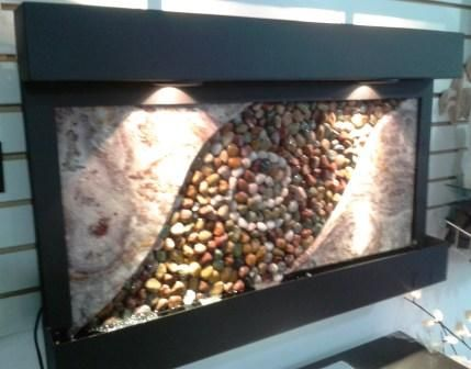 fuente de pared o muro lloron en acero cantera y piedras de rio con diseo