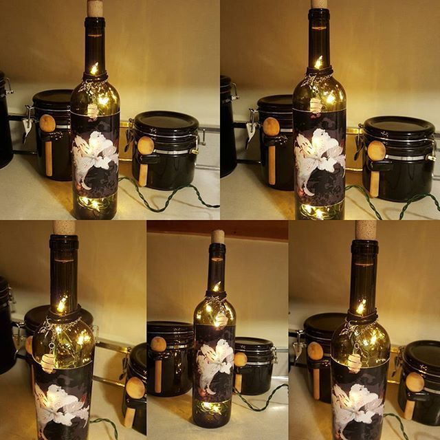A wine bottle lamp using my abstract lily picture available for digital download in my Etsy store. Keeping this lamp for myself! ☺ #winebottleart #winebottlecrafts #upcycledwinebottles #winebottlelamp #winebottle