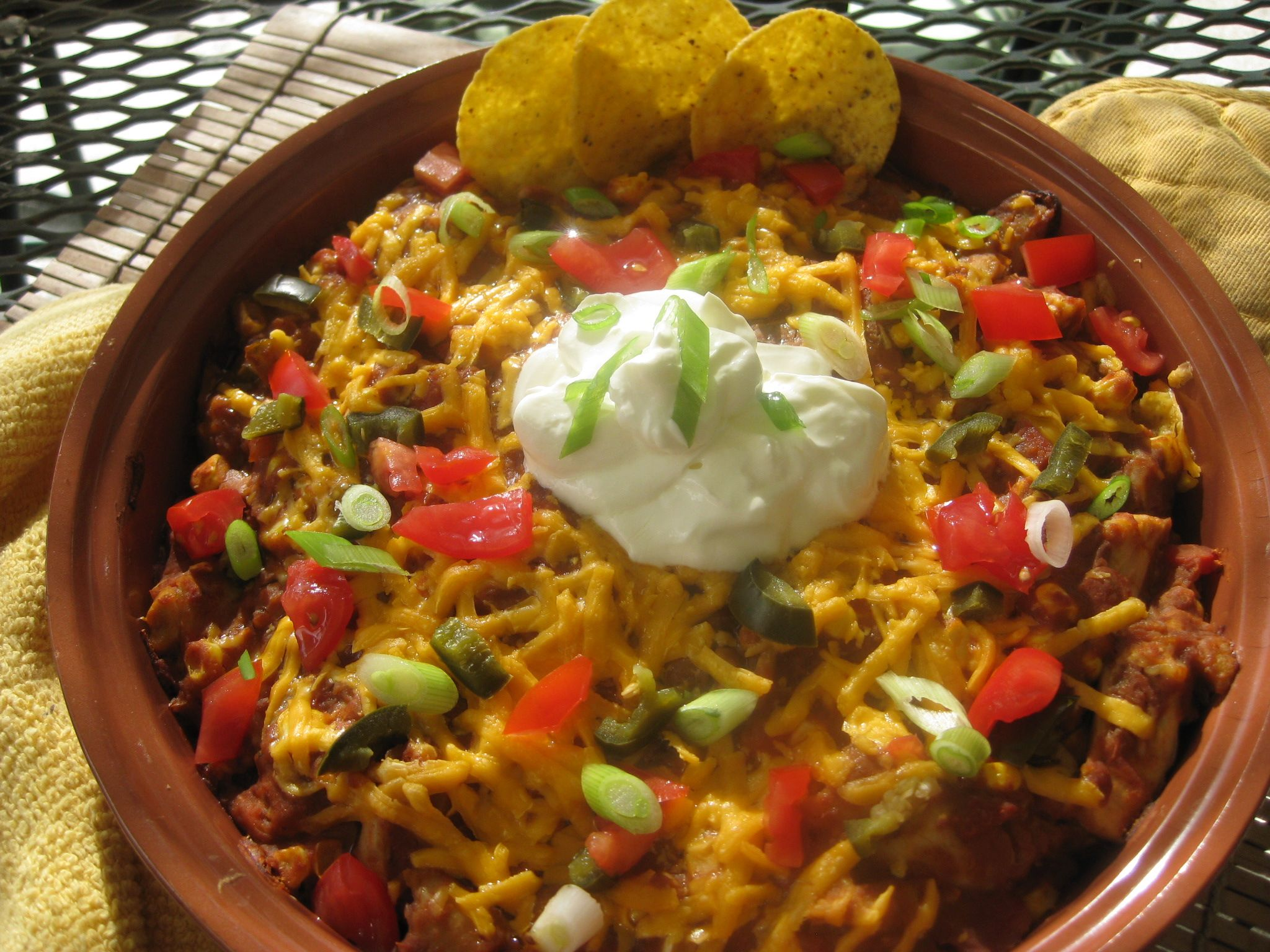 Easy Mexican Chicken with Tortilla Chips - I think I'll make this in individual dishes so everyone gets their own surrounded by chips on a plate. Might add some diced red and yellow pepper to the meat mixture... #mexicanchickentacos
