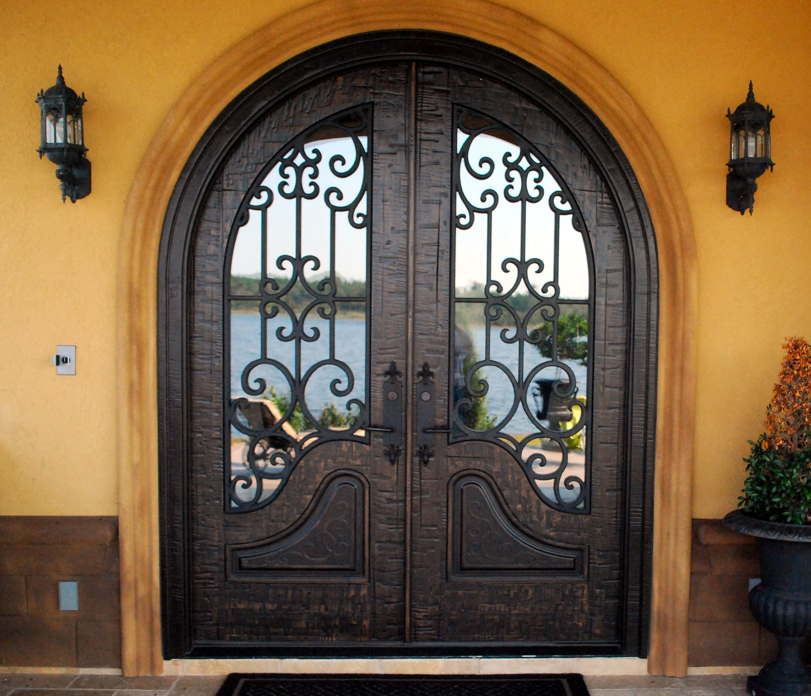 Double front entry doors almaria panel design true for Main two door designs