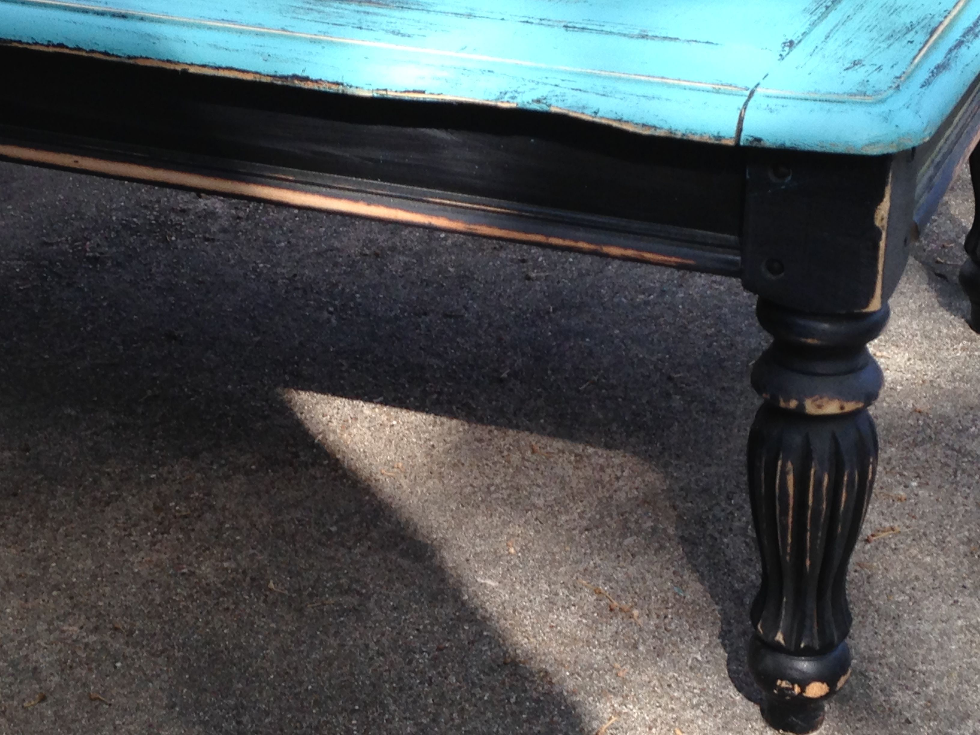 Here Is A Coffee Table With A Turquoise Top And Black Legs That Is