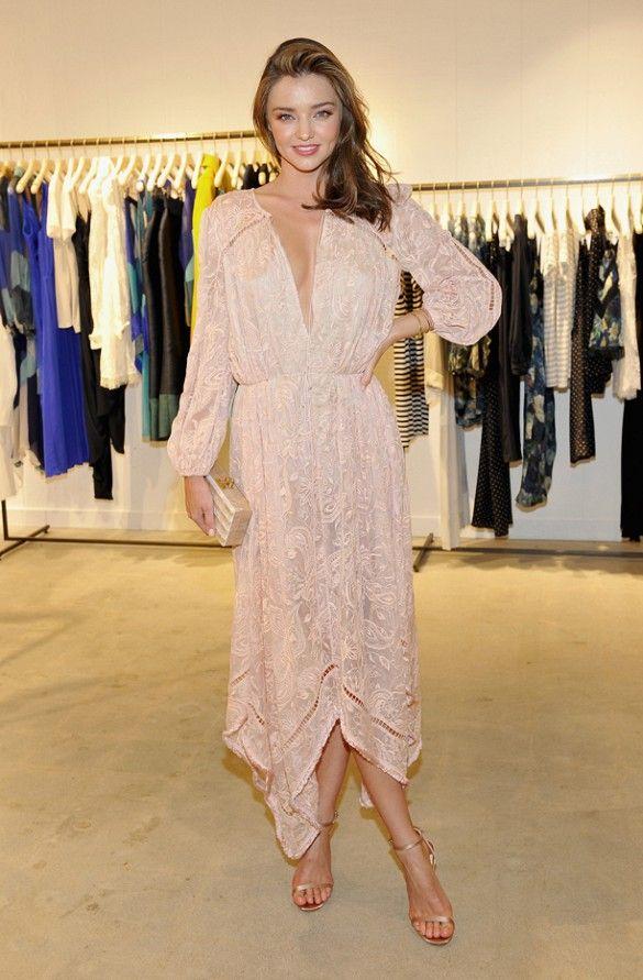 b7dfdab02ec39 Miranda Kerr wears a pink lace Zimmermann dress with metallic satin heels  and a matching clutch