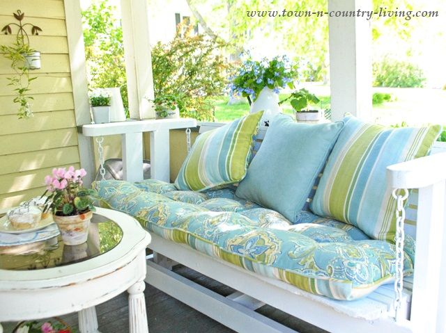Beautiful Farmhouse Porch Glider Makeover With Paint And New Outdoor Cushions