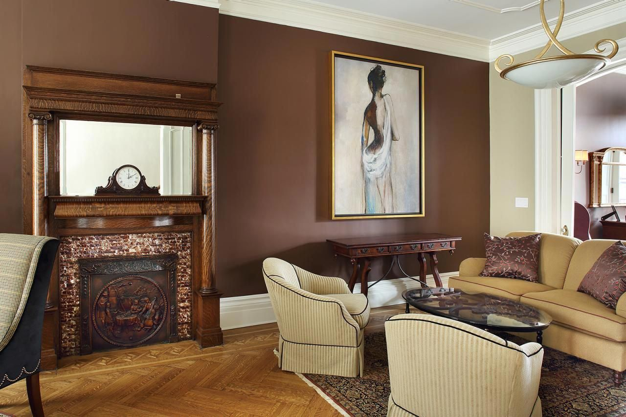chocolate brown walls create a warm inviting atmosphere