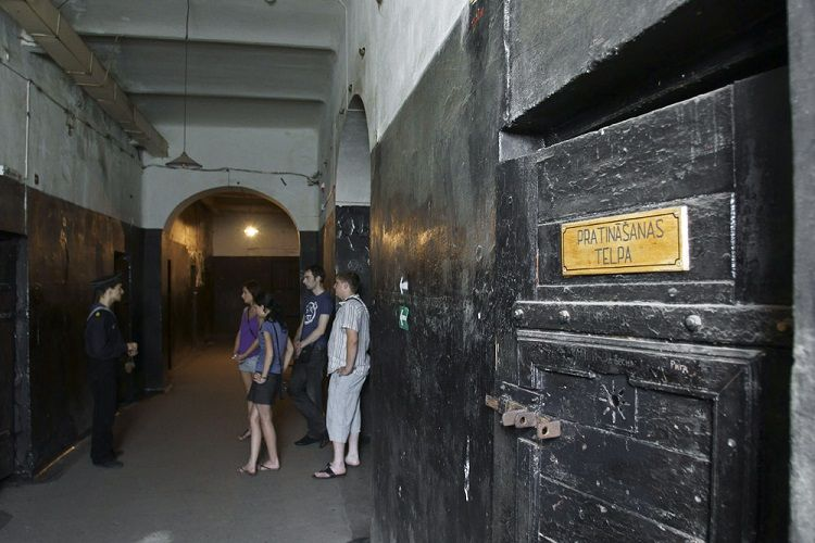 Karosta Prison - Guard and guests in corridor