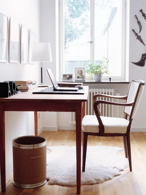 simple home office design with wood table and wall art for the