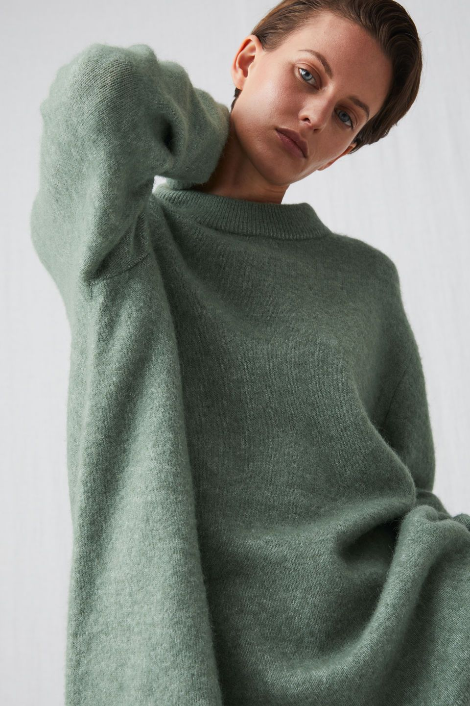 f6a710f880355b 222032-114 Alpaca Blend Knitted Tunic. The mix of alpaca and wool gives a  soft and cosy feel to this slightly oversized knitted tunic.