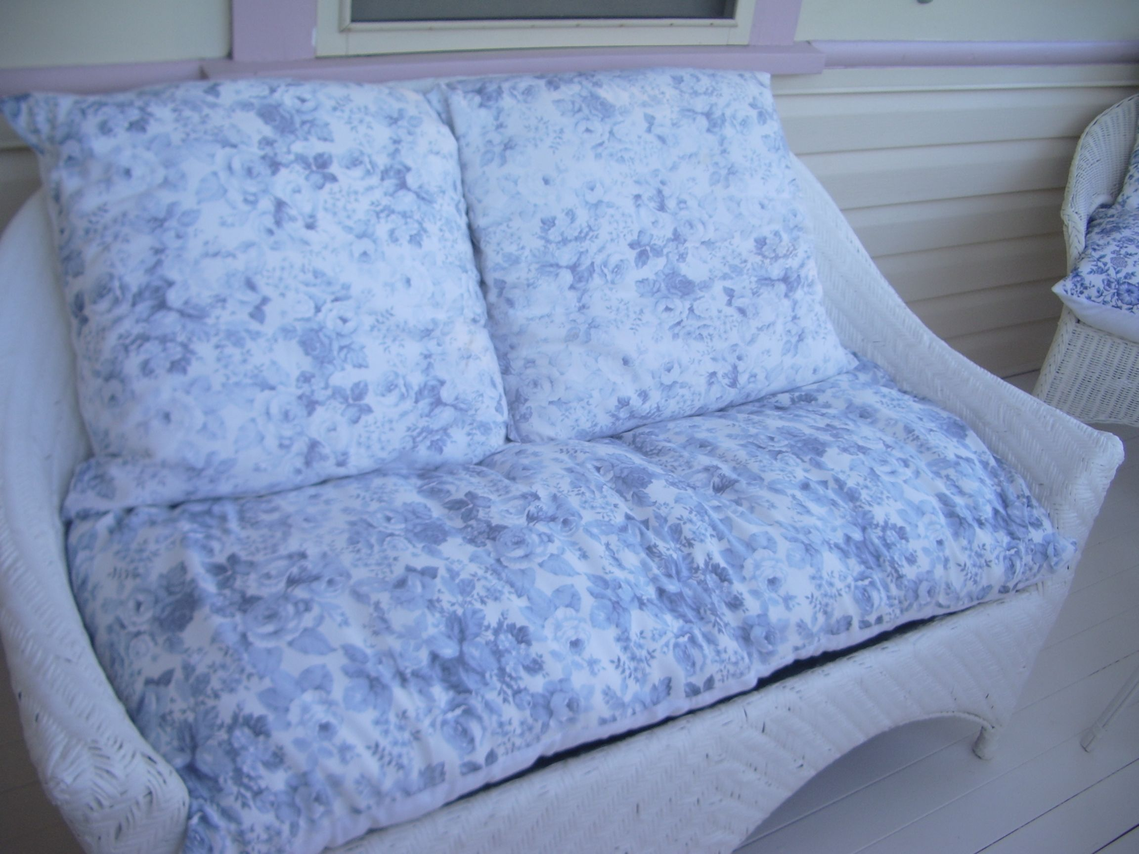 This wicker lounge was once a very yucky brown, heaps of white paint later & blue & white cushions I made she is so comfy...