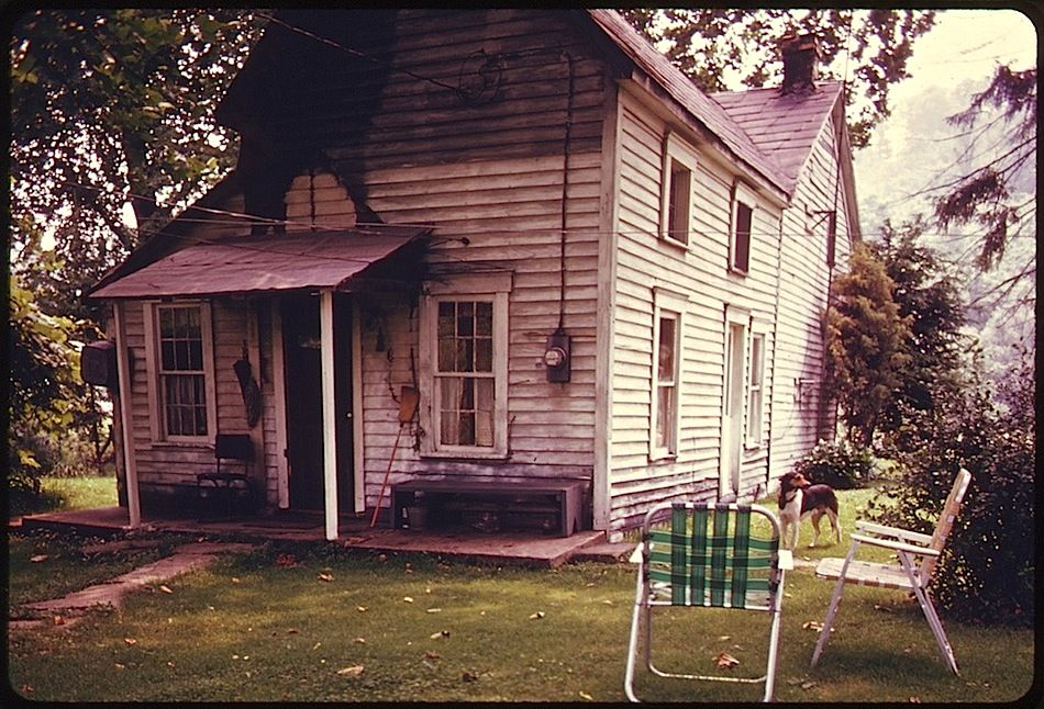 """""""Residents of an older home,* built in the 1850's, take advantage of the summer weather to sit on their front porch off Route #800."""" Barnesville, Ohio, July1974. Below,the back …"""