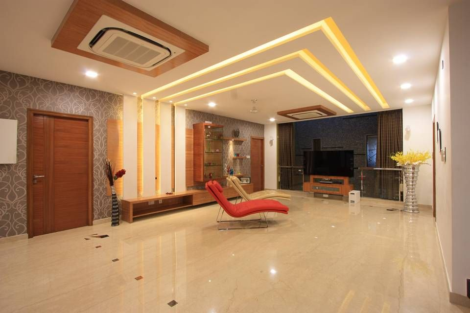 View of simple and sleek false ceiling and courtyard in the family room  divided by glass