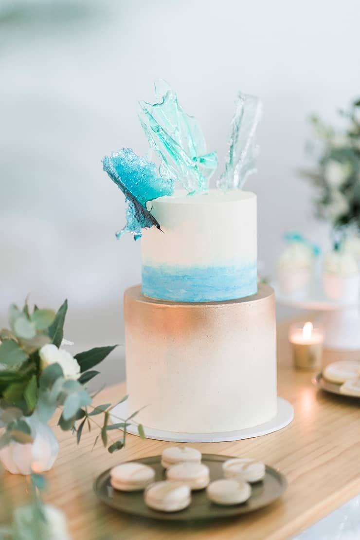 Beach wedding cake brushed with gold and aqua watercolour and topped ...