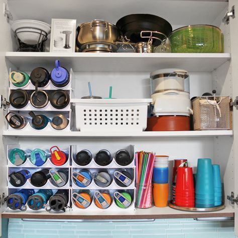 {five minute friday} Water Bottle Storage #cabinetorganization Water Bottle Storage solution! How to organized kitchen cabinets with quick five minute organizing projects. Perfect kitchen cabinet organizers for water bottles, plastic cups, straws, and more. #cabinetorganizers