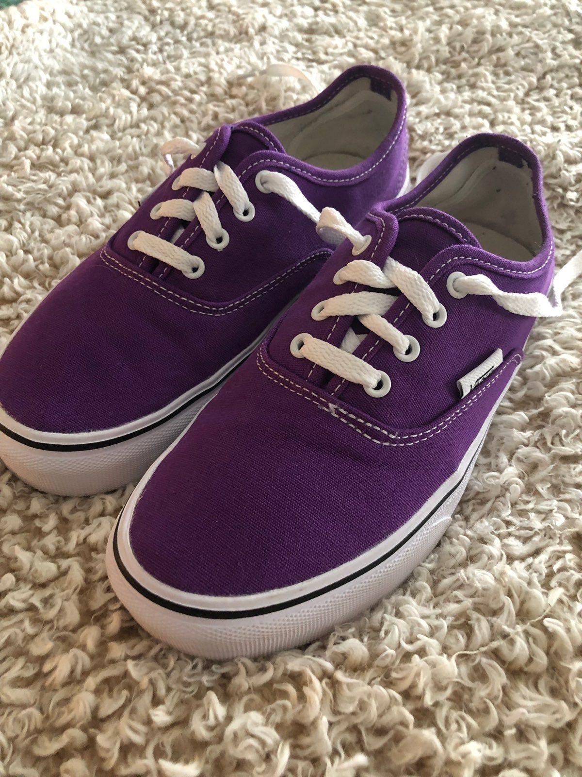 Purple VANs tennis shoes. Super cute