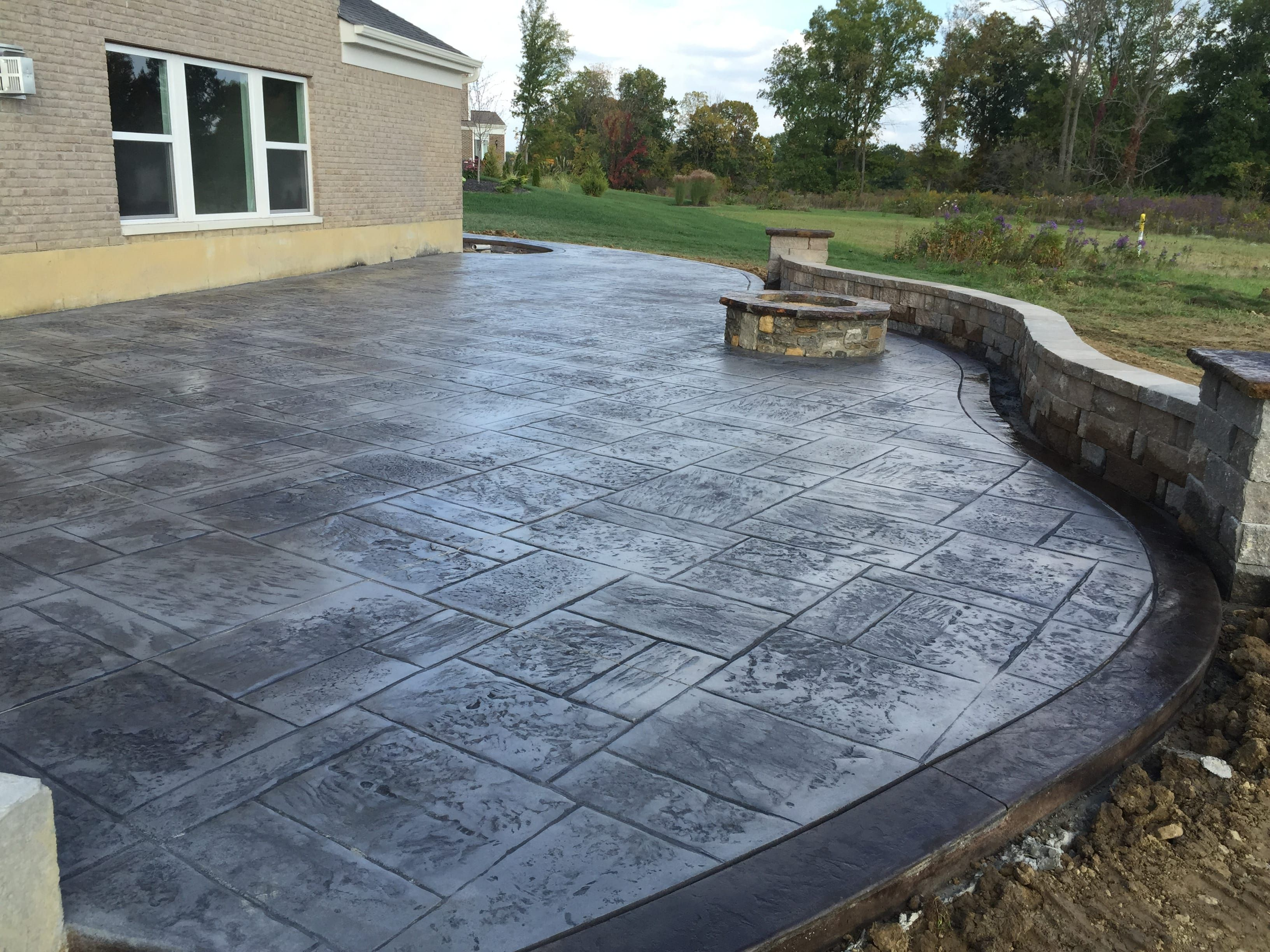 Stamped Concrete With Seating Walls Columns And Fire Pit Loveland Ohio Stamped Concrete Concrete Decor Stamped Concrete Patio