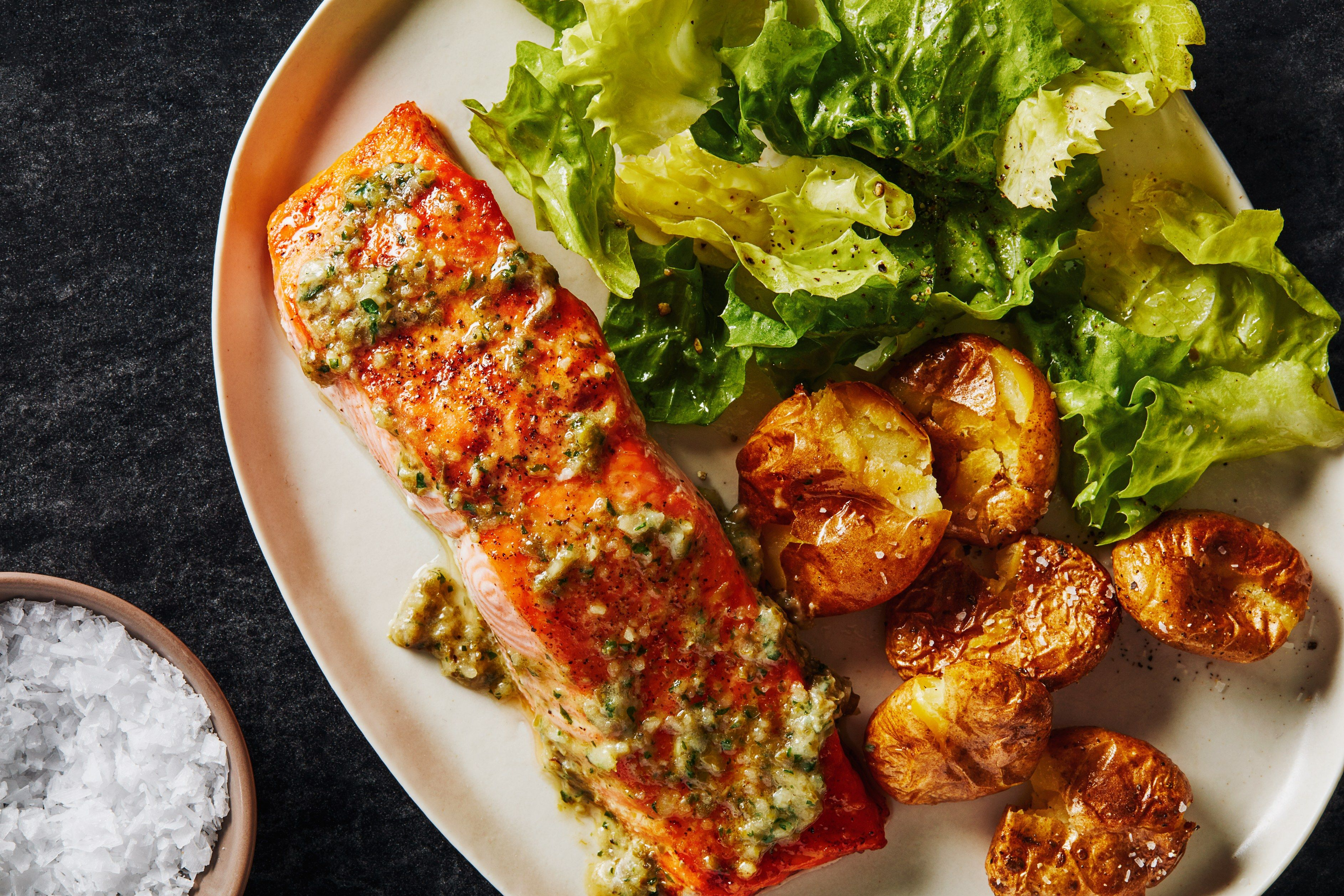 Butter flavored with garlic, anchovies, capers, lemon, and parsley makes quickly broiled salmon fillets extra enticing.