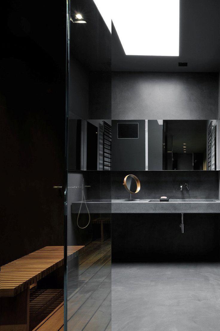 Maurizio pecoraros elegant home in milan moody black and teak bathroom