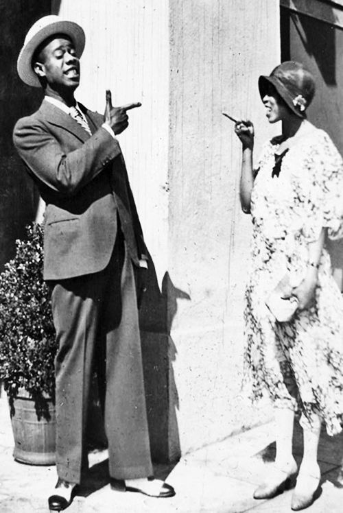 Louis Armstrong and wife, Lil Harden Armstrong. Lil, was herself, a gifted musician in her own rights and certainly a liberated, strong-willed woman in the male dominated world of Jazz.
