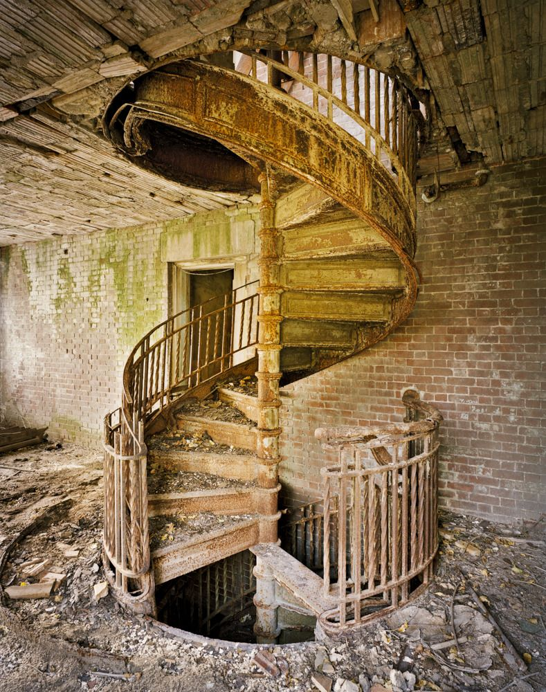 Spiral staircase on New York's forgotten North Brother Island – Photograph by Christopher Payne.*