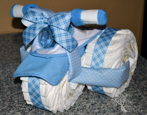 9 Clever How To Make A Diaper Cake Instructions Diaper Cake For Baby Shower  Several