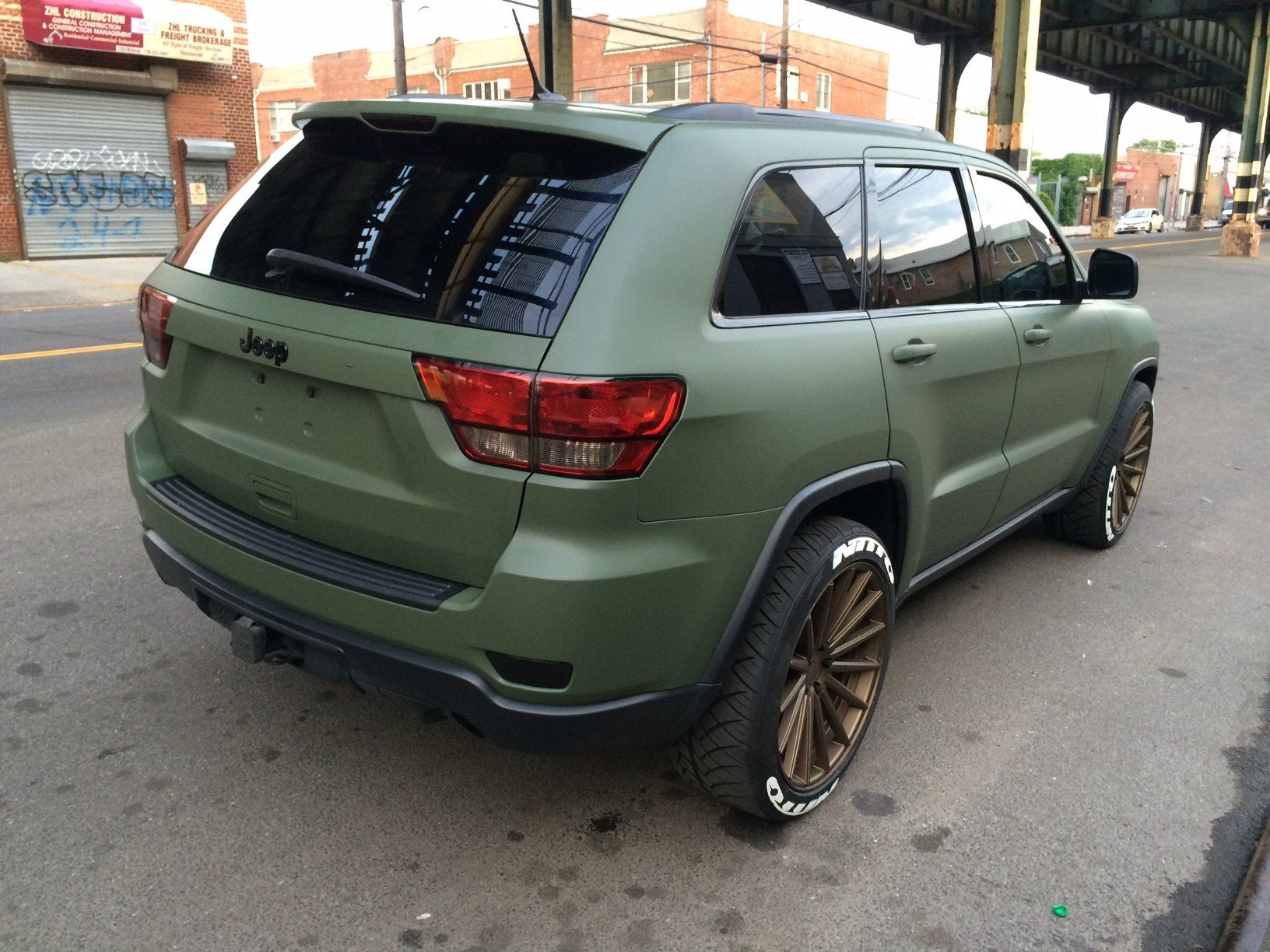 Jeep Awareness Green Matte Jeep Grand Cherokee Wearing Bronze Rims Carid Com Gallery In 2020 Jeep Grand Jeep Grand Cherokee Green Jeep