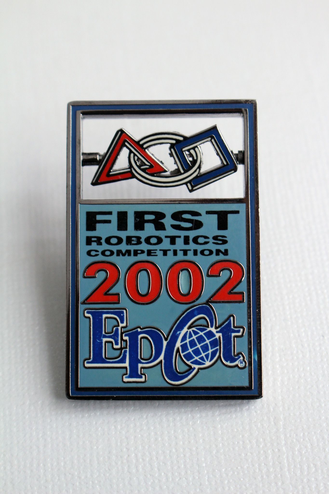 This Disney Pin Features The Logo For The First Robotics Competition