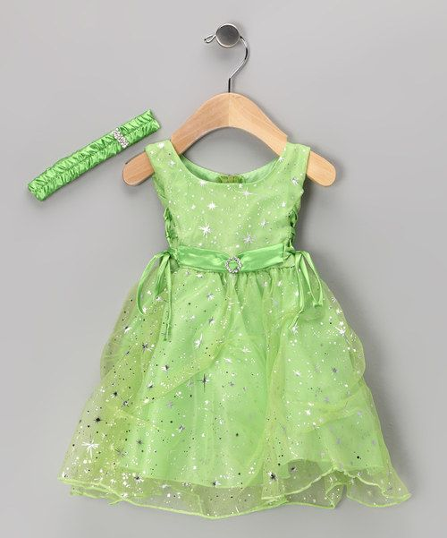 Sparkling stars dance across the tulle skirting of this enchanting dress while its bodice is accentuated by corset lacing at the sides and a zipper at the back. An elastic headband adds the finishing touch to this breathtaking outfit.Includes dress and headbandInfant sizes include diaper cover100% polyester