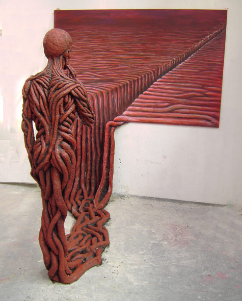 Michal Trpák, Escape into reality (What does a painting think?). 2007, cement, wood, acrylic. Trpák: Escape into reality is a combination of a painting, a relief and a sculpture. It outlines a transition between the real and virtual world, between 2d and 3d, between sensed and tangible.
