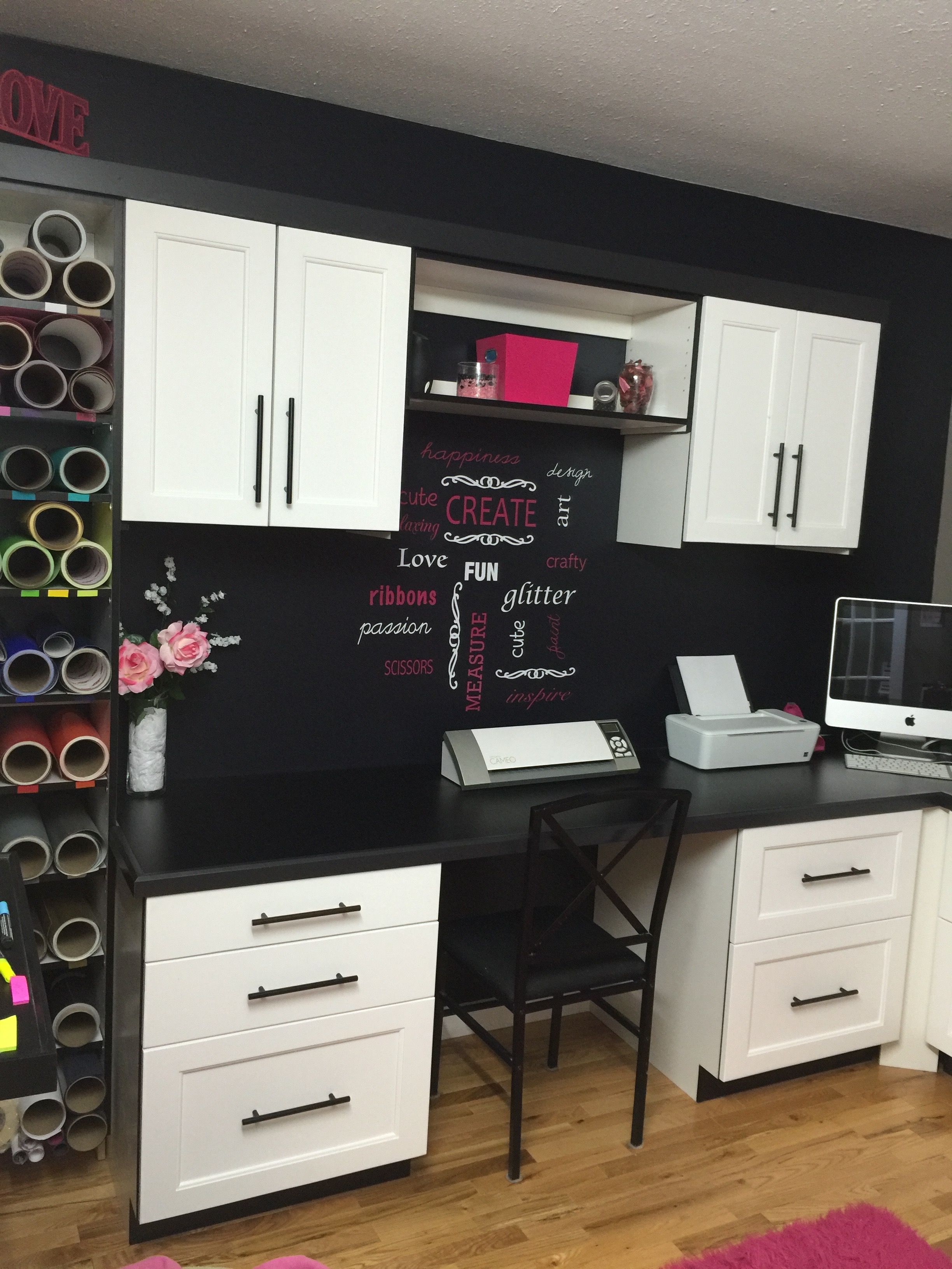Craft room build in Vinyl roll storage black and white with pink