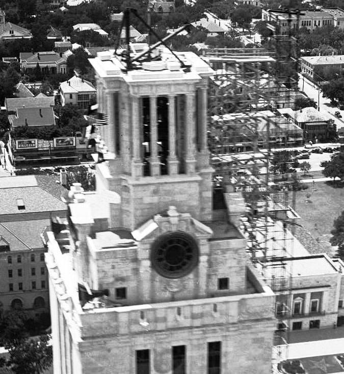 Above: An aerial view of the not-quite-finished UT Tower in 1936. The clock faces haven't been installed, and the scaffolding on the north side supports a crane to lift the Tower's bells for the carillon at the top. Down below, on the left is the old Woman's Building (used for the drama department by the 1930s and burned in the 1950s), and the newly opened Hogg Auditorium on the right.