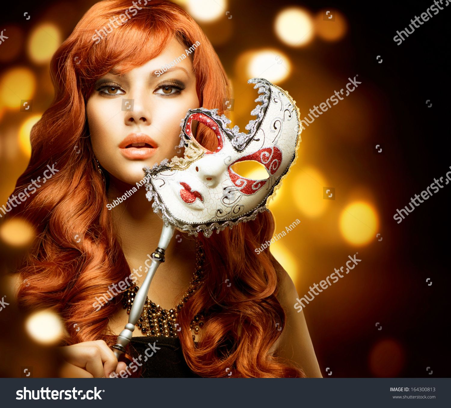 Beautiful Woman with the Carnival mask. Holiday Fashion Girl