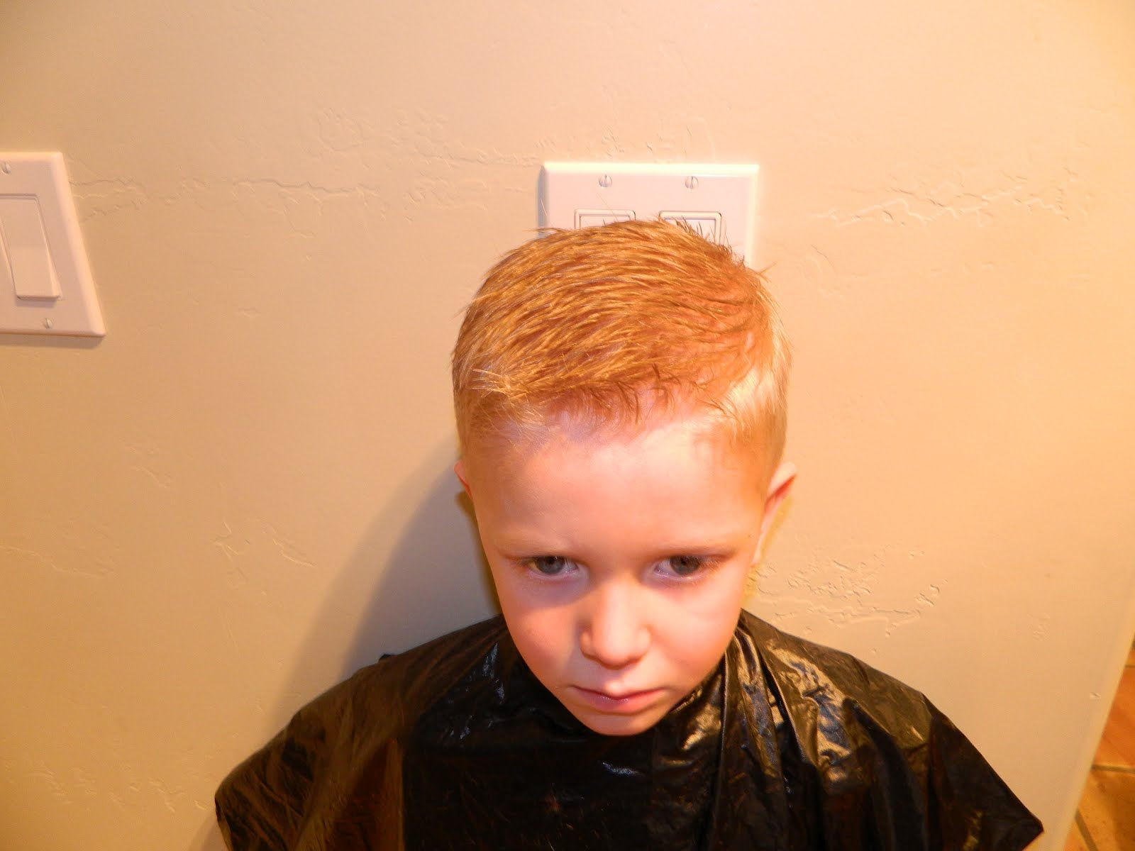 Awesome tutorial. Now if I can get Z to stop screaming and flailing so I can do it, we'll have a win! - Boys Hair cuts 101