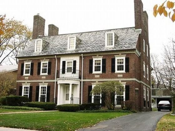 A Georgian Colonial Revival home. This example is shaped like a rectangular  box, very