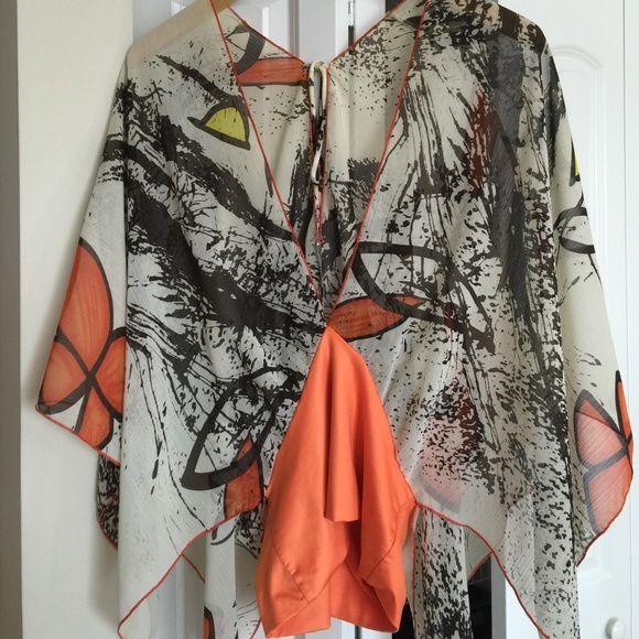 Beautiful handkerchief shirt Beautiful handkerchief shirt .. Ties in the back .. Great orange ... It looks amazing on Tops