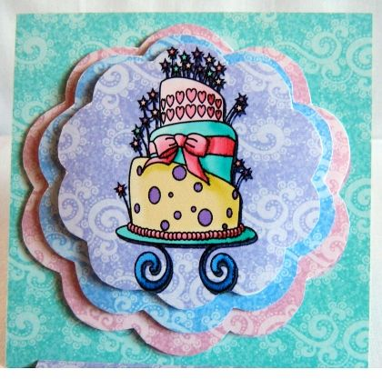 """This 3D card has three layers. The top layer has the image of a tiered birthday cake.  Blank for you to add your own personal message.  3.75"""" x 3.75""""  9.5cm x 9.5cm"""