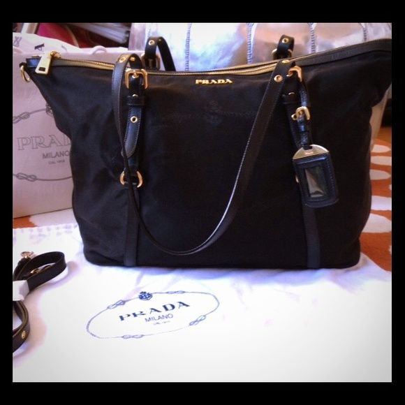 Prada Tessuto nylon with saffiano leather tote New Authentic Prada. Never  used. Durable nylon with saffiano leather handles 5d8f5de32799c