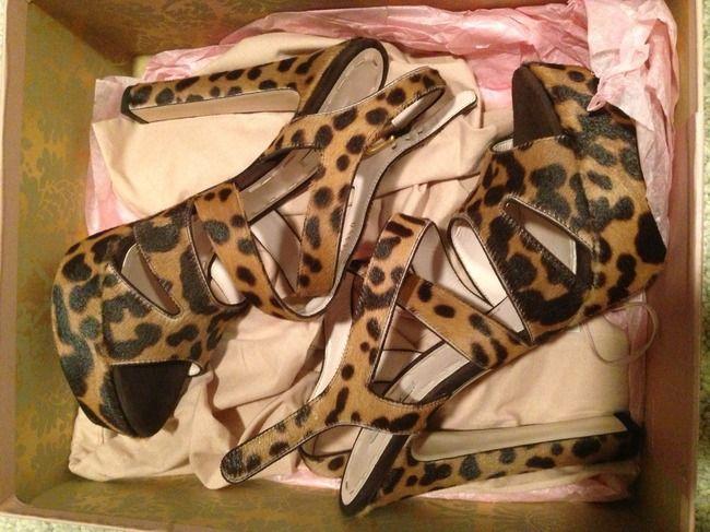 http://www.lovvd.com/products/miu-miu-leopard-calf-hair-platform-sandals