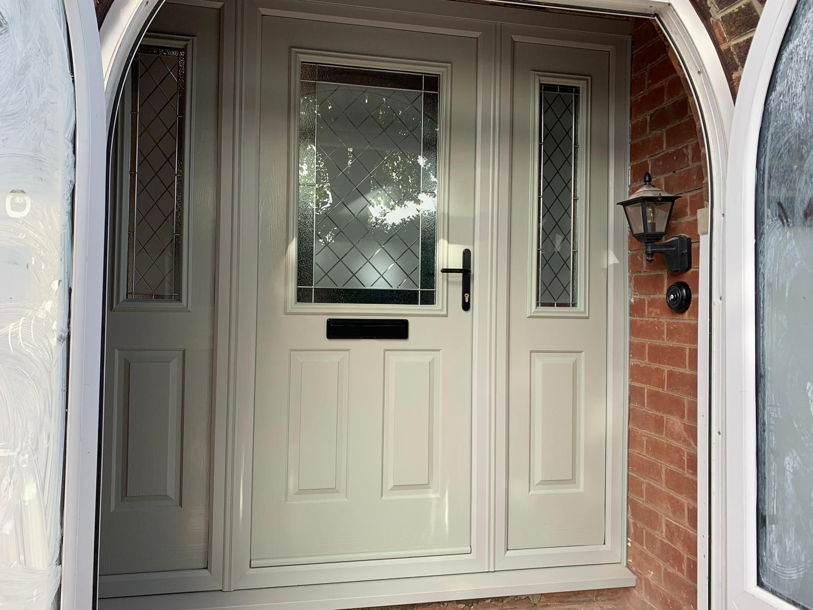 Painswick Beeston 1 Solidor Composite Door With Brilliant Glass Black Hardware And Composite Side Panels For A F Composite Door Window Company Double Glazing