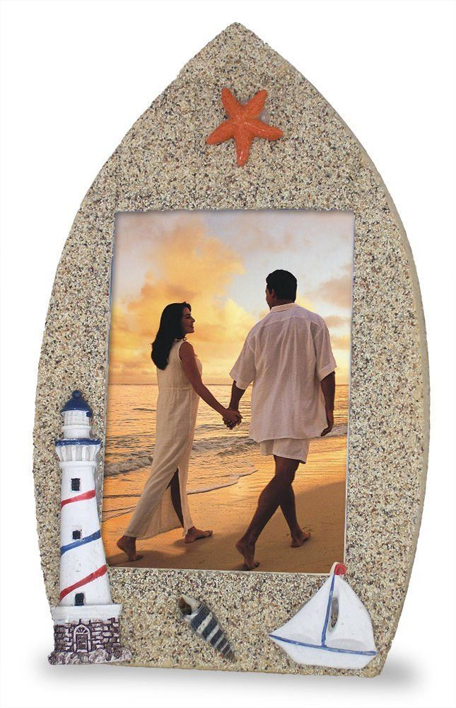 Boat Shaped Picture Frame With Lighthouse Sailboat Starfish U0026 Shell   Sand  Texture Background   Nautical