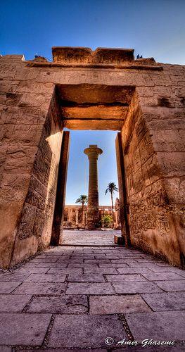 Pillar vs. Pylon Main courtyard of Karnak temple complex viewed from temple of Ramesses III, Luxor, Egypt.